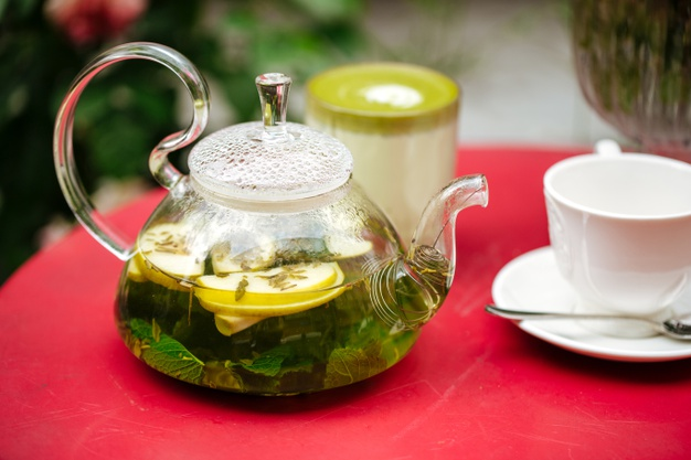 closeup on glass teapot with green mint tea and cup 219193 4029
